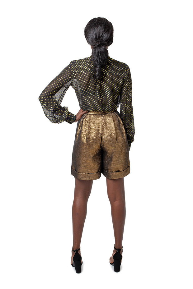 Front of model wearing bronze Lizette wide leg shorts