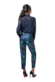 Back of model wearing purple floral Cami relaxed fit cropped pants