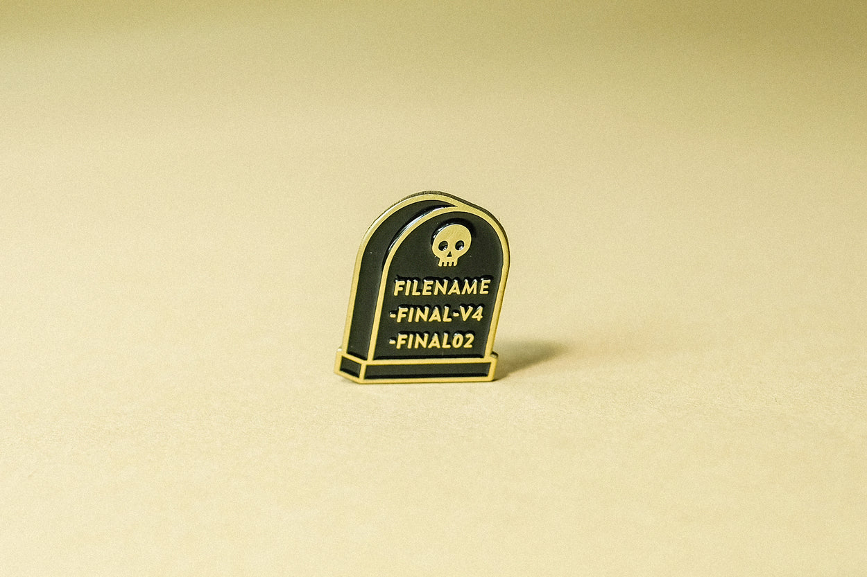 Final File enamel pin