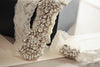Bridal garter with rhinestones on lace