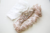 Designer bridal garter set in blush and rosegold color
