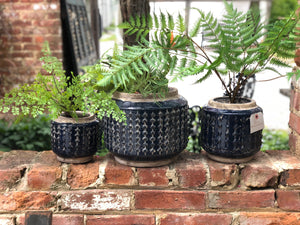 Blue knobby ceramic pots