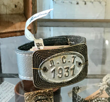 Load image into Gallery viewer, 1931 vintage tag and leather shoe cuff