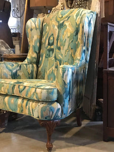 Antique Wing Chair upholstered in jacquered peacock