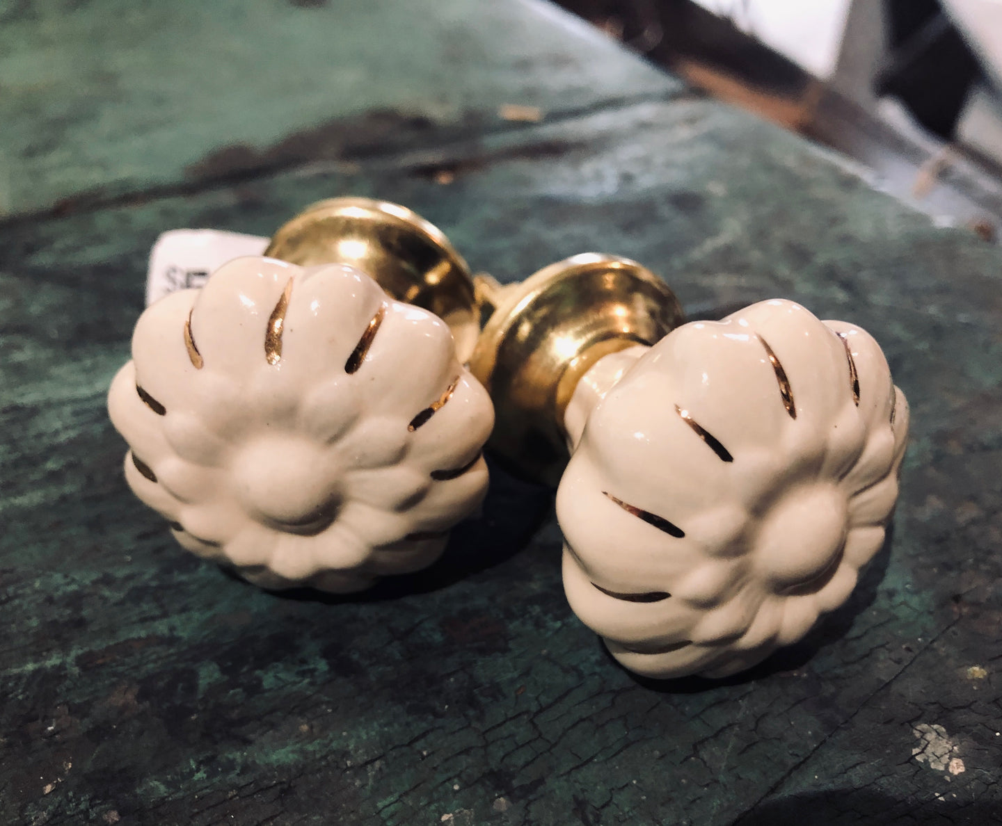 White daisy pulls/knobs with gold accents