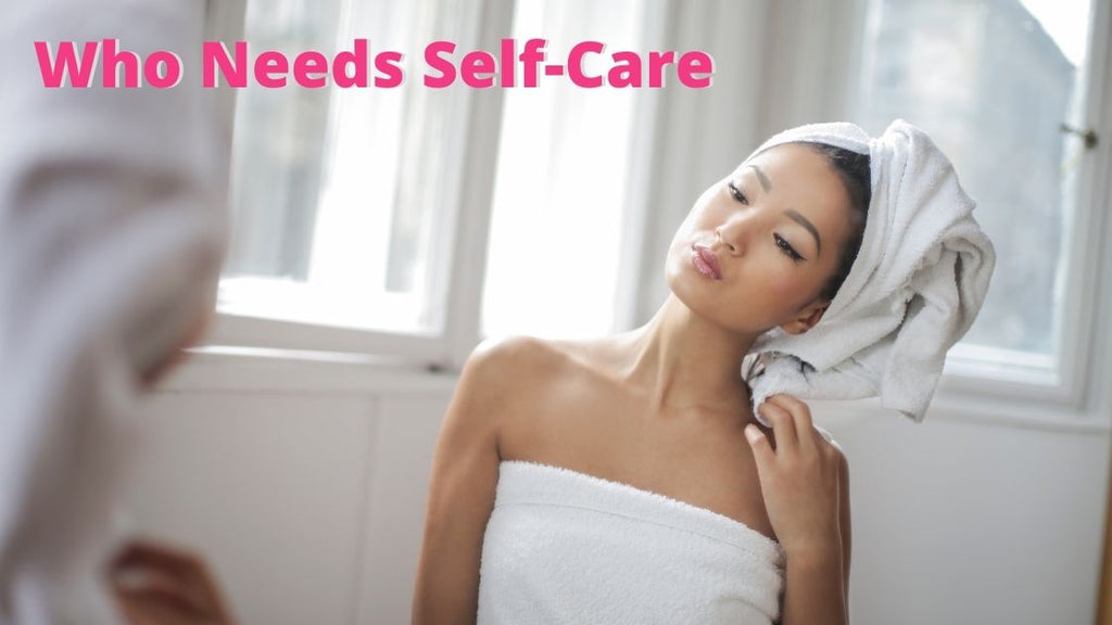 woman admiring herself after washing hair - self-care