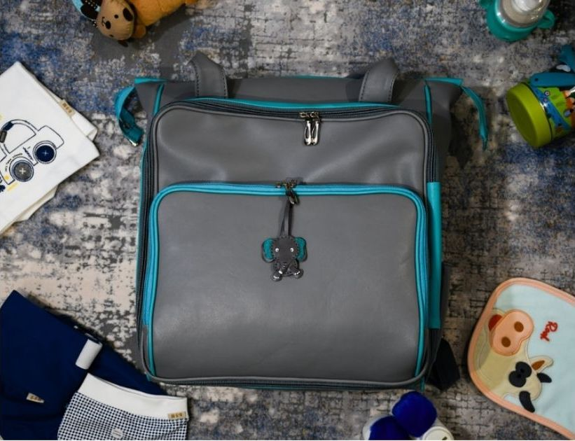 baby's diaper bag and accessories