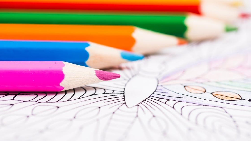 multiple colored pencil on adult coloring page