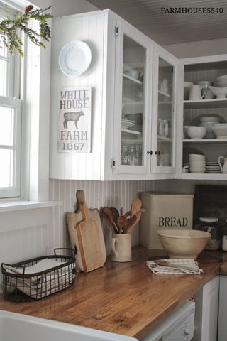 White Cabinets- Nothing speaks farmhouse kitchen better than white cabinets.