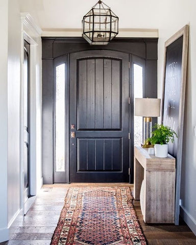 This black farmhouse entry exudes with a strong masculine flair.