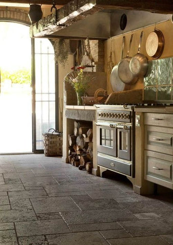 05 Pot Racks - . Serving both form and function, this design places your essential cookware within reach, and also creates a rustic aesthetic to a rather plain wall.