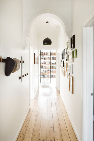 Hats off to this hallway, which was smartly equipped with hooks and hangers to put galleries and head covers and display.