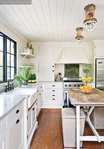 Wooden Floors - A classic farmhouse kitchen feature, hardwood floors offer a timeless look to the area