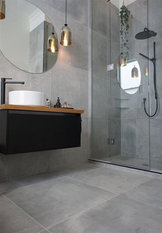 A full-on concrete interior paves the way to introduce a timeless look in your bathroom.