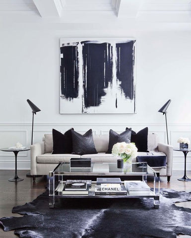 A pair of handsome floor lamps adds symmetry to this black and white masculine living room. Lighting Melbourne Australia