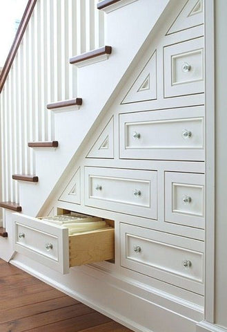 A perfect tip for the practical parent, using the empty parts of the staircase into doors and drawers is pure genius.