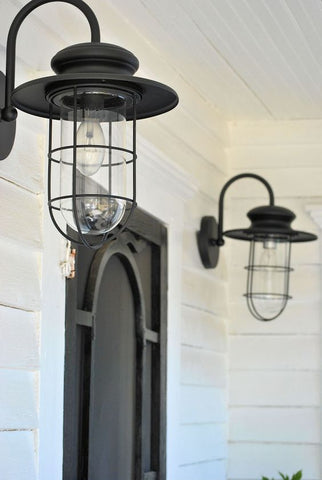 A wall light or two by the front door immediately adds a touch of cheerfulness in your outdoor facade