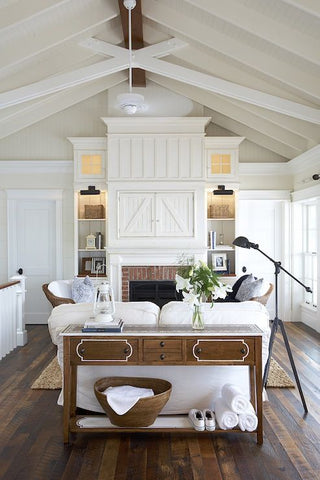 Beach inspired living room - like how they are keeping this space breezy with a ceiling fan