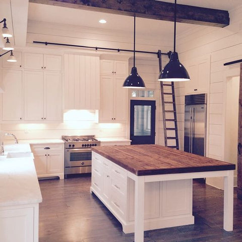 Countertop - How about adding a delightful countertop in your empty corner A butcher's table atop a pretty, white chest, with a seating slot and an industrial light to brighten thin