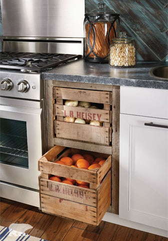 Crates. Pile up to or three wooden crates and use them as your storage for food. Other than these serve as a practical container for your particulars, the industrial appeal of wooden crates adds to your kitchen's aesthetics.