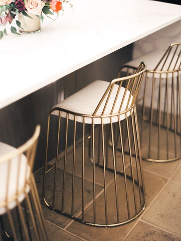 Decorate your living room spaces with stools and tables with tasteful brass accents.