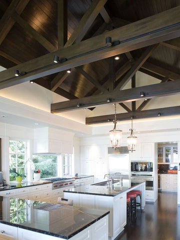 High-roofed lofts are ideal places for track lighting systems. Mount rows of spotlight fixtures overhead and add a stylish flair to your exposed beams.