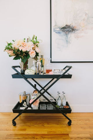 How about a drink trolley Set up your very own cocktail station to display your favourite items. Plus, you can wheel it around your apartment whenever you have guests coming over!