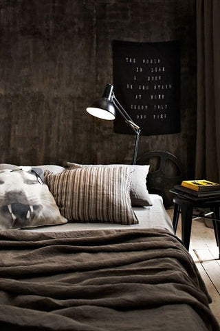 Its dark, earthy colours make this masculine themed bedroom largely industrial