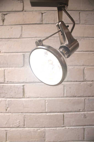 This LED track light with swivel arm oozes old school styling with its retro feel and bare lamp holder. It has an adjustable supporting arm for different bulb lengths and a robust metal housing for the lamp holder. It