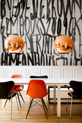 Large graphics, bold colours, chic furniture and copper pendant lights