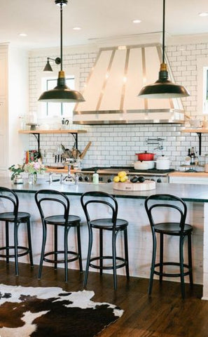 Lighting. Industrial lighting is one of the key features of a farmhouse kitchen, and you can easily cop of various rustic looks with a tasteful vintage light