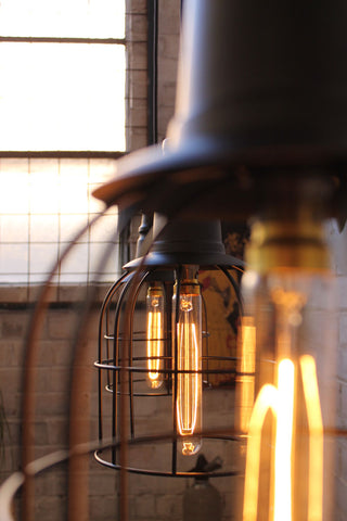 Make a statement with your industrial lighting choices. These cage lights are among the best, practical options for that quick, industrial kitchen atmosphere.