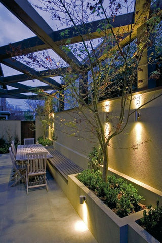 Make use of outdoor up-down lights to spark up a lovely setting