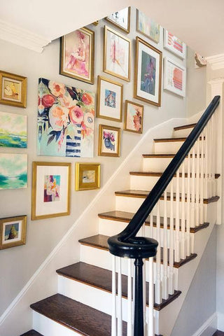 Perk up those empty walls with an exhibition of your beloved works and the right lighting for staircases as take lights