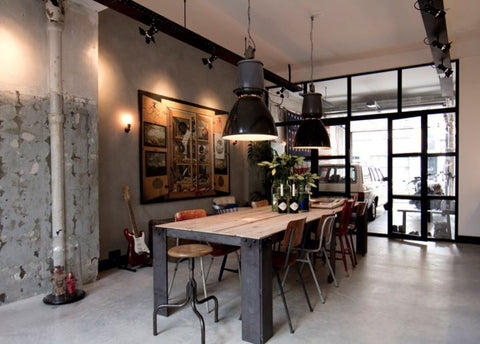 A couple of large industrial pendant lights overhead the dinning room