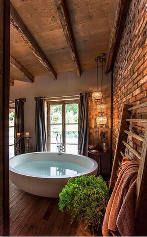 Rustic bathroom Create an invigorating sanctuary with raw, organic beauty, thanks to stone and wood-clad walls.
