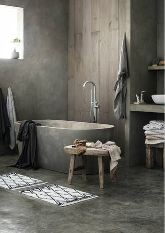 Simplify the look of your bathtub with a concrete basin and enjoy your daily dips with a utilitarian flair.