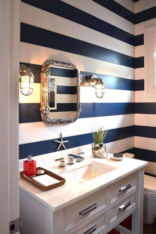 a fresh, nautical turn in your bathroom with these wall lights, very beach interior inspiration