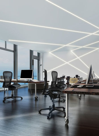 The designers of this workspace have decided to strip the walls off its boredom and created a wild, imaginative look, with the help of linear lighting