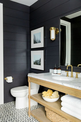 This handsome bath is black and mysteriously masculine