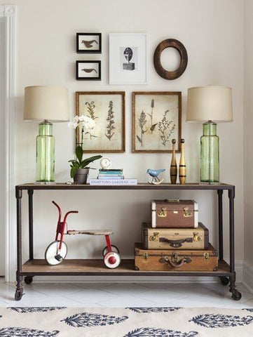 This is what an entryway is all about. Pair of table lamps, artwork and trinkets