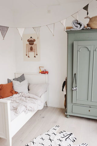 This vintage kids' bedroom is effortlessly clean and easy on the eye, making it a perfect space for a boy or a girl.