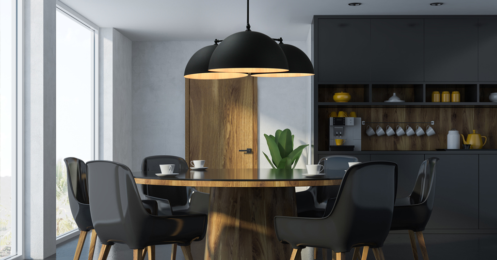 Three light black pendant light over table