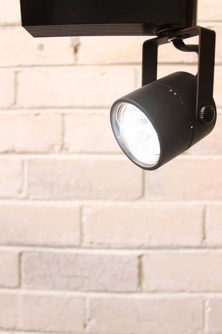 This 12 volt adjustable arm track light has a clean compact urban look with its rounded metal mesh back and matt black finish. The shade head is made from quality die cast aluminium and has a generous 180 degree tilt and 340 degree swivel action.