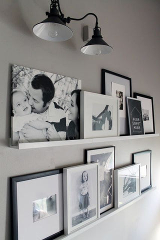 Twinning a pair of black wall industrial lights brightens up childhood memories in this lovely corner