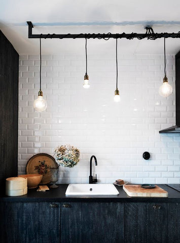 exposed pendant lights work well to define the space in a kitchen