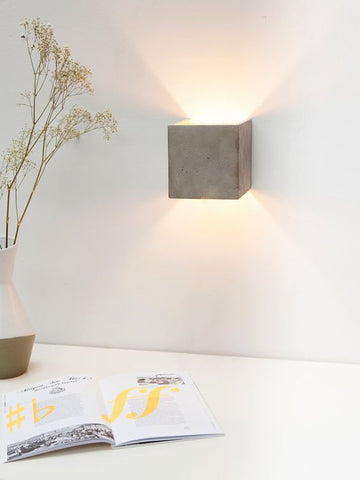 We love this a up down, boxed wall light that instantly cheers a blank, white corner.