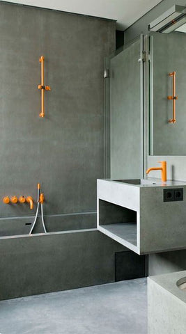 When it comes to industrial bathrooms, always remember that less is more. Add a surprising hue, like bright orange or a fun lime, to break off the monochromatic look.