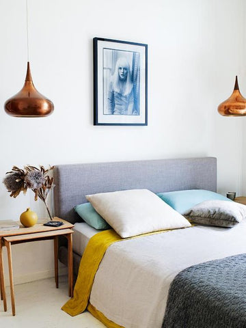 With the pendant just hovering overhead, your new bedside decor will be nicely lit for a showcase. Tip Hang your bedroom pendant lights a foot between the tabletop or your chosen dec
