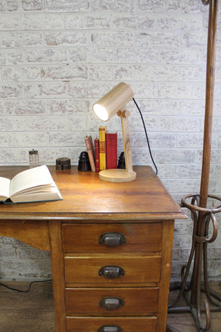 a wooden table lamp has a simple stylish design. It is sure to add a bold and beautiful statement to your desk or office setting.